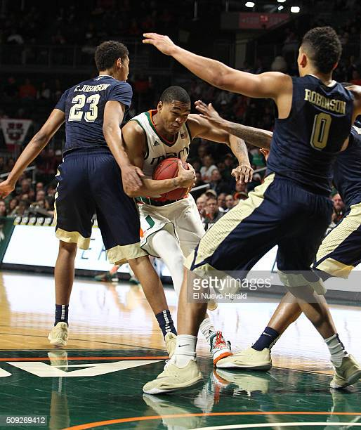 Miami's James Palmer middle drives against Pittsburgh's Cameron Johnson during the first half at the BankUnited Center in Coral Gables Fla on Tuesday...