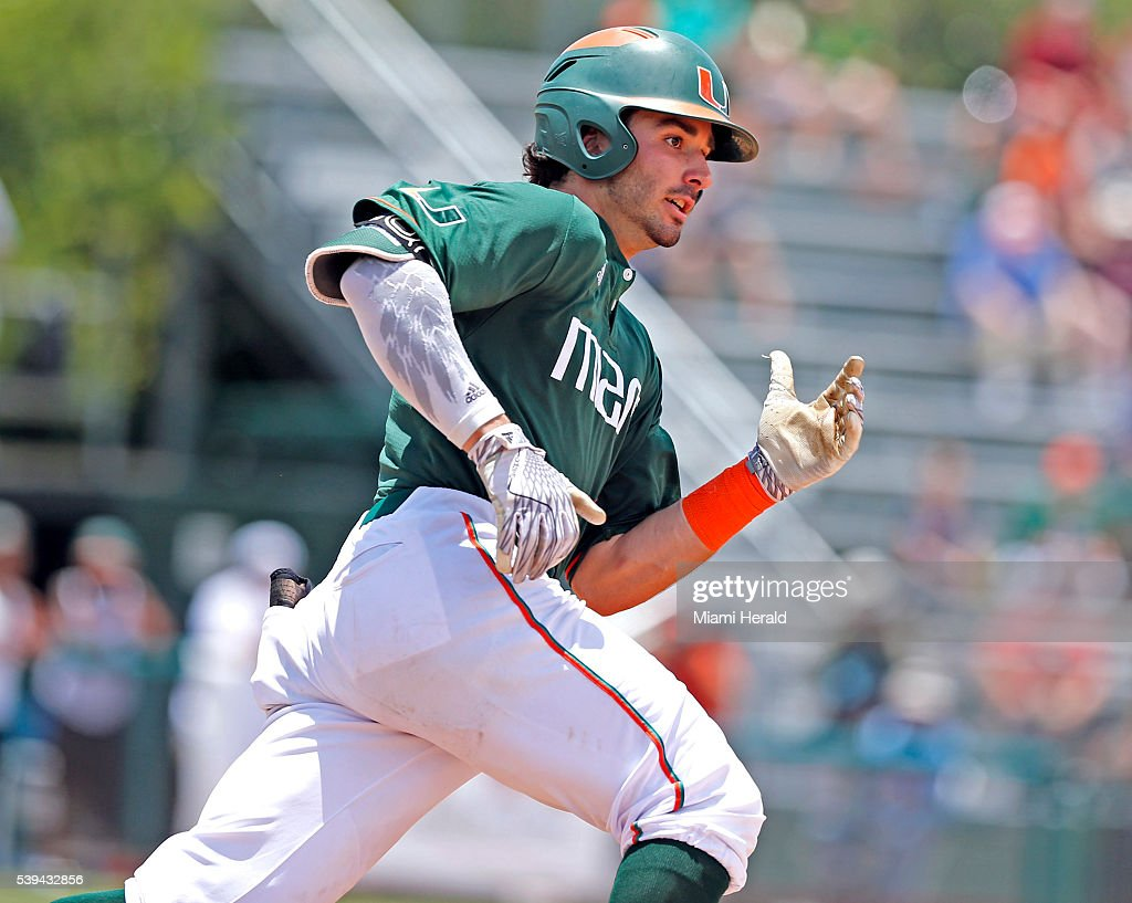 Miami's John Ruiz runs out an RBI triple in the fifth inning against Boston College in the NCAA Tournament's Coral Gables Super Regional at Alex...
