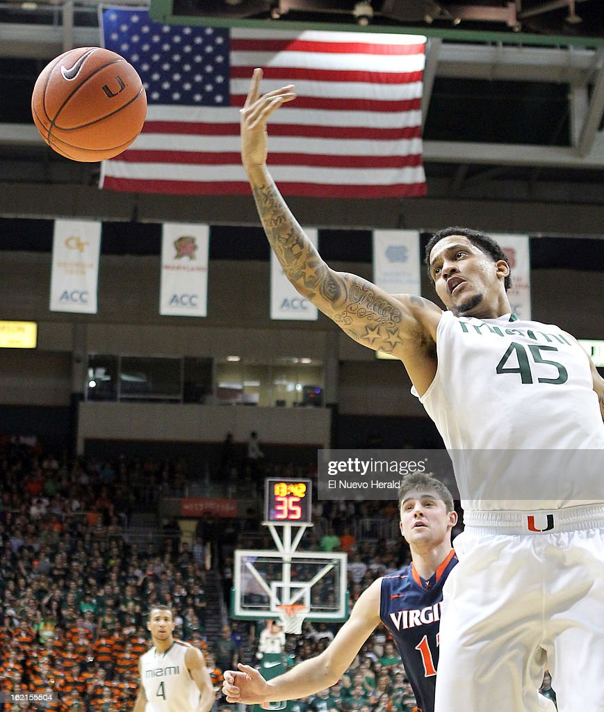 Miami's Julian Gamble (45) battles for a lose ball against Virginia's Joe Harris during the first half at The BankUnited Center in Miami, Florida, on Tuesday, February 19, 2013.
