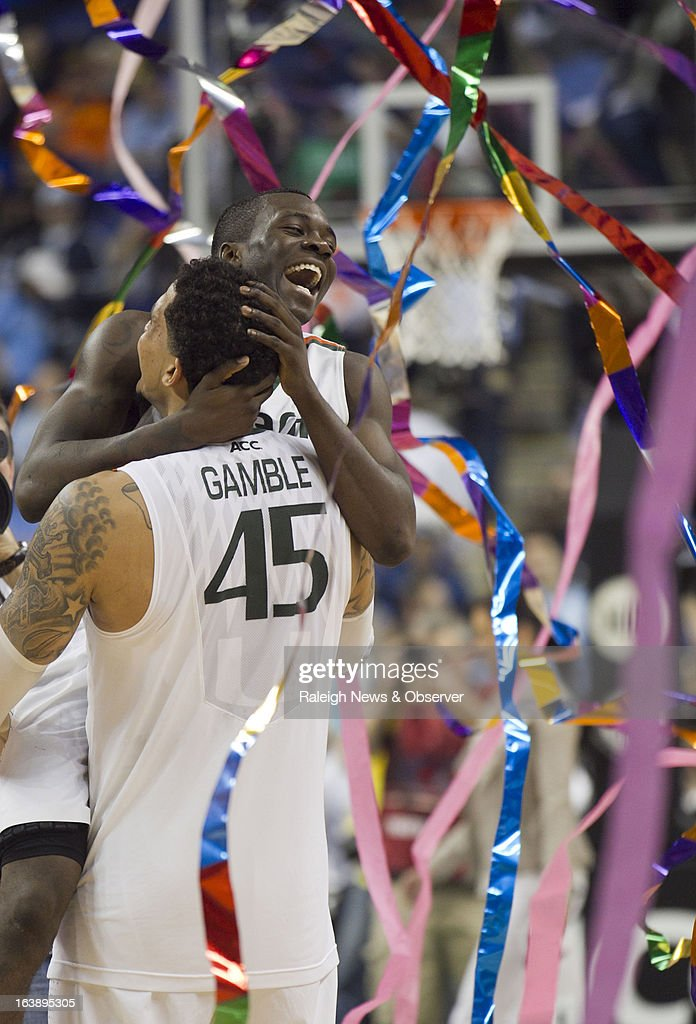 Miami's Julian Gamble (45) hoists teammate Durand Scott (1) following the Hurricanes' 87-77 victory over North Carolina in the finals of the men's ACC basketball tournament at the Greensboro Coliseum in Greensboro, North Carolina, Sunday, March 17, 2013.