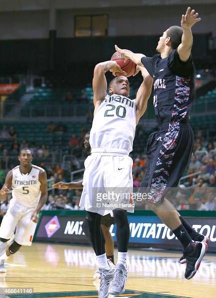 Miami's Manu Lecomte goes to the basket against North Carolina Central's Nimrod Hilliard during the first half of National Invitation Tournament...