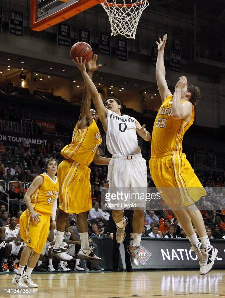Miami's Shane Larkin middle makes a basket between Valparaiso defenders late in the second half of the firstround game of the NIT Tournament in Coral...