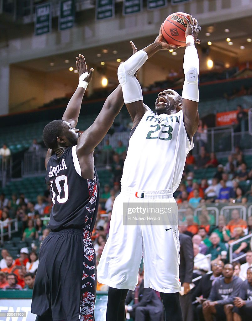 Miami's Tonye Jekiri goes to the basket against North Carolina Central's Jamal Ferguson during the first half of National Invitation Tournament...