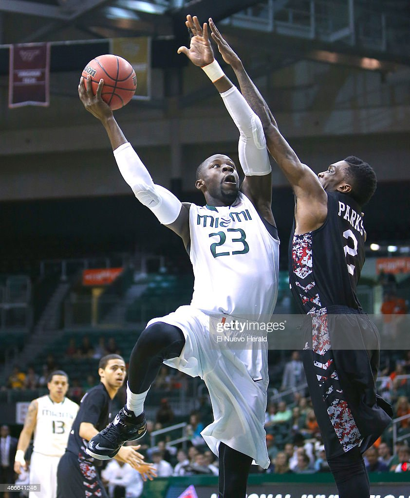 Miami's Tonye Jekiri goes to the basket against North Carolina Central's Jordan Parks during the first half of National Invitation Tournament...