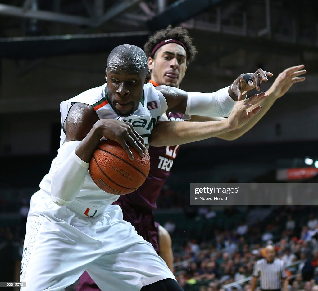 Miami's Tonye Jekiri grabs a rebound in front of Virginia Tech's Will Johnston during the second half at the BankUnited Center in Coral Gables, Fla., on Wednesday, Feb. 18, 2015. The host Hurricanes won, 76-52.