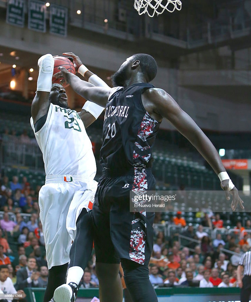 Miami's Tonye Jekiri left goes to the basket against North Carolina Central's Jamal Ferguson during the second half of National Invitation Tournament...