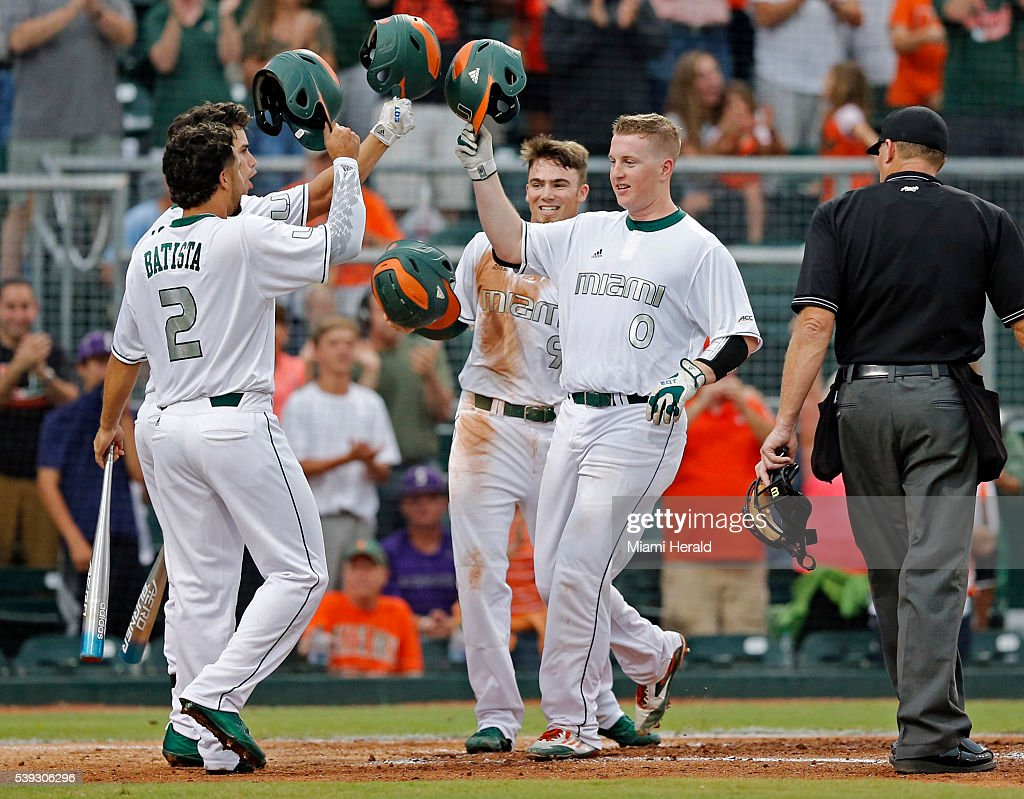 Miami's Zack Collins hits a threerun home run in the third inning against Boston College greeted by teammates Randy Batista Brandon Lopez and Carl...