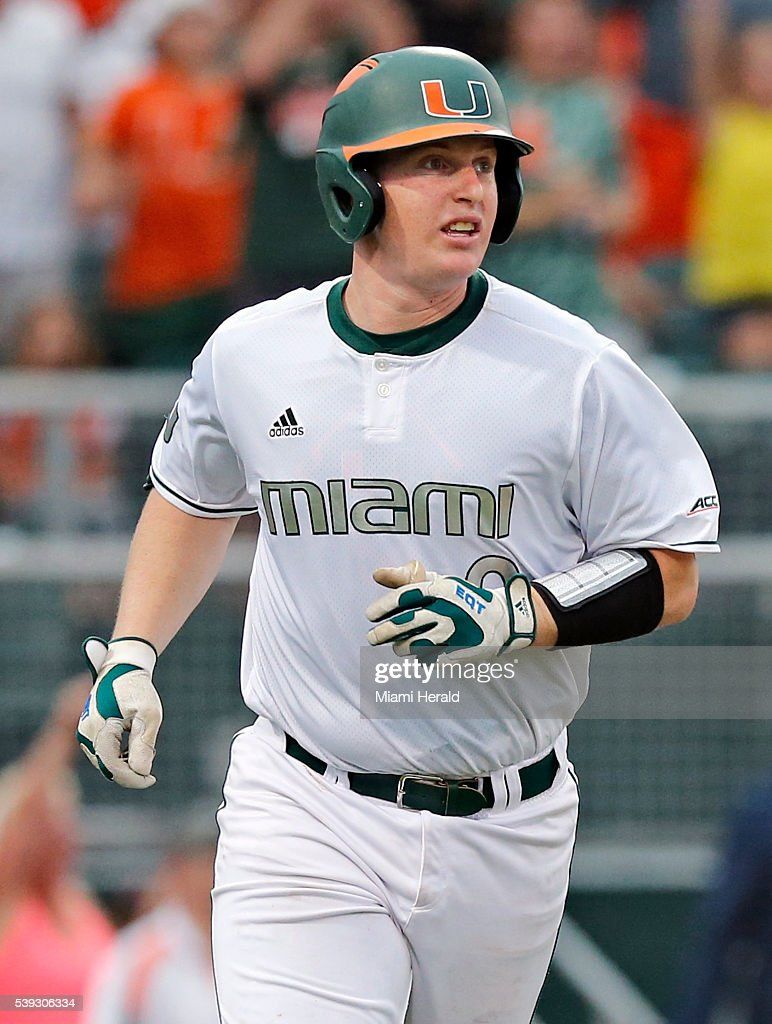 Miami's Zack Collins watches the ball after hitting a threerun home run in the third inning against Boston College in the opener of the NCAA...