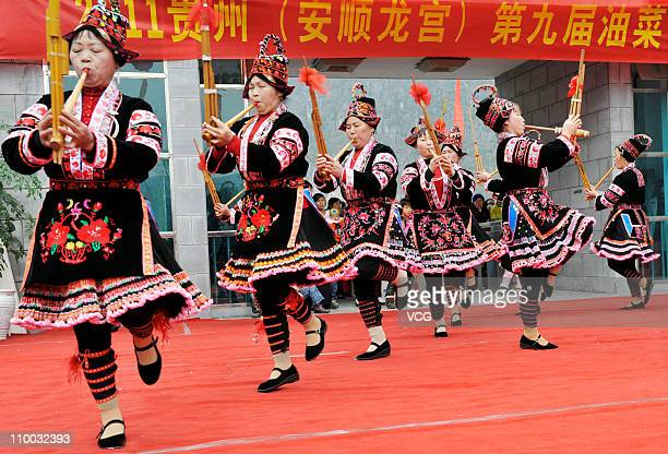 Miao people dance and play music during the 9th Guizhou International Rapeseed Oil Festival at Anshun Dragon Palace Scenic Area on March 12 2011 in...