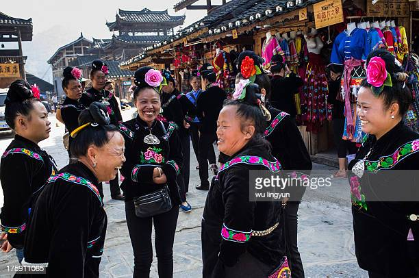 CONTENT] Miao women were talking and laughing in street of Xijing Miao village Guizhou province