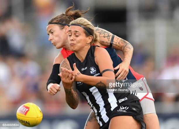 MiaRae Clifford of the Demons spoils a mark by Moana Hope of the Magpies during the round two AFL Women's match between the Collingwood Magpies and...