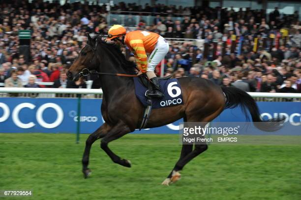Mia's Boy ridden by jockey Andrea Atzeni goes to post in the Makfi Suffolk Stakes