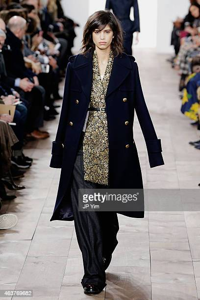 Mica Arganaraz walks the runway at the Michael Kors fashion show during MercedesBenz Fashion Week Fall at Spring Studios on February 18 2015 in New...