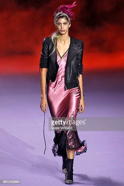 Mica Arganaraz walks the runway during the Haider Ackermann Ready to Wear show as part of the Paris Fashion Week Womenswear Spring/Summer 2016 on...