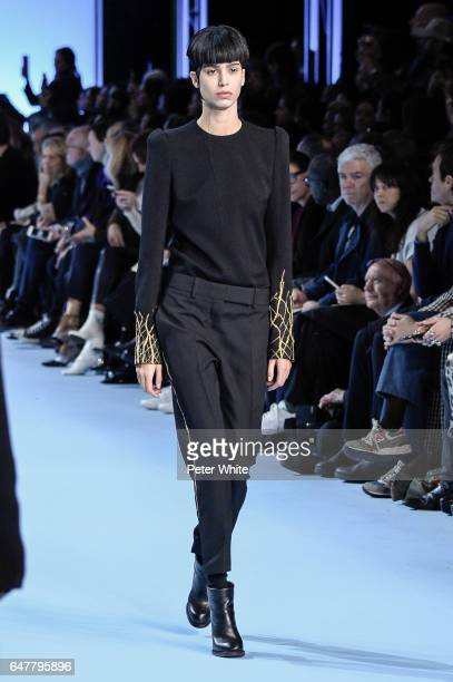 Mica Arganaraz walks the runway during the Haider Ackermann show as part of the Paris Fashion Week Womenswear Fall/Winter 2017/2018 on March 4 2017...