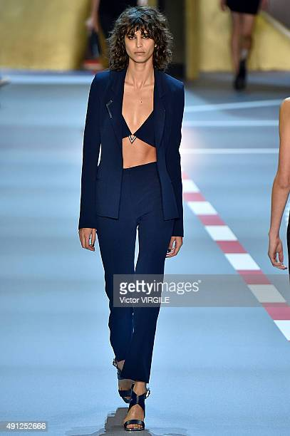 Mica Arganaraz walks the runway during the Mugler Ready to Wear show as part of the Paris Fashion Week Womenswear Spring/Summer 2016 on October 3...