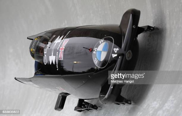 Mica McNeill and Montell Douglas of Great Britain compete during the Women's Bobsleight first run of the BMW IBSF World Cup at Olympiabobbahn Igls on...