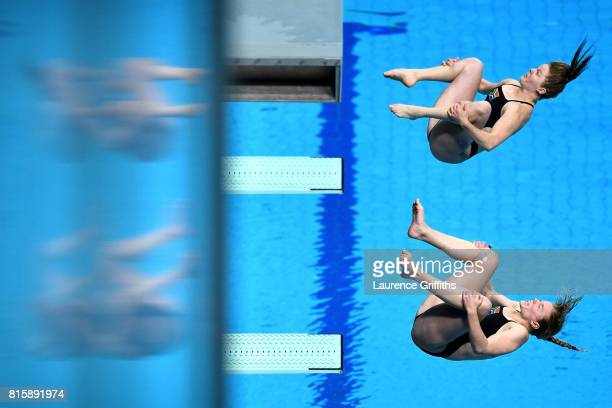 Micaela Bouter and Nicole Gillis of South Africa compete during the Women's Diving 3M Synchro Springboard preliminary round on day four of the...
