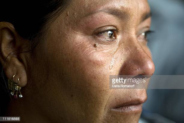 Micaela cries while she watches her eldest son Luis Alberto board a plane for Tijuana at the Oaxaca airport where he will attempt to illegally cross...