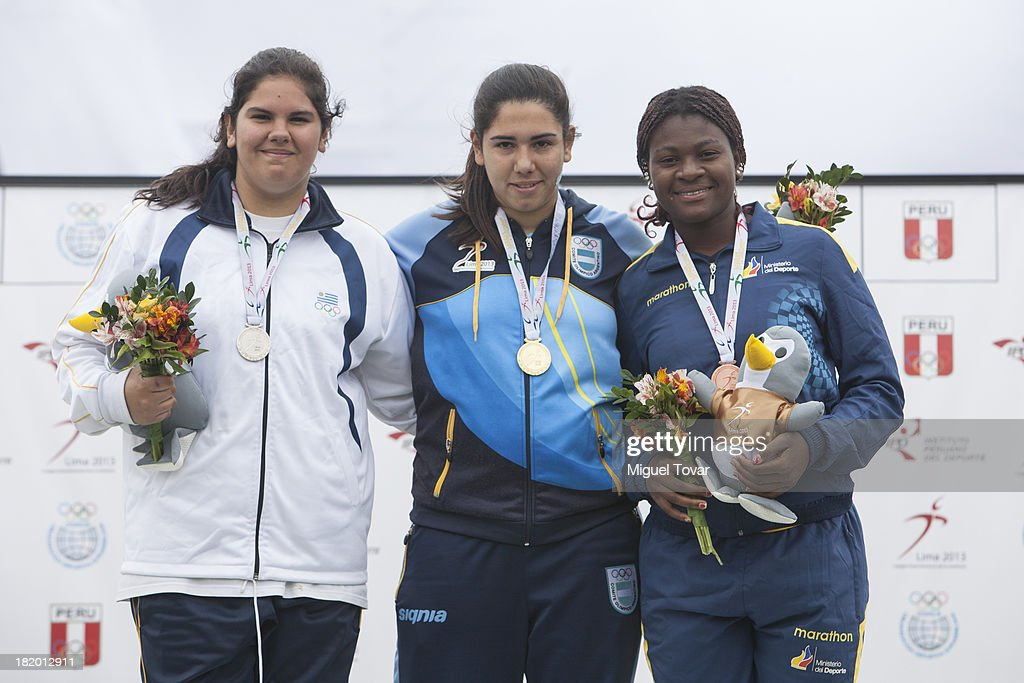 Micaela Garbarino of Uruguay, Ailen Armada of Argentina and Jenny Mina of Ecuador in the podium of Women's Discus Throw as part of the I ODESUR South American Youth Games at Estadio Miguel Grau on September 27, 2013 in Lima, Peru.