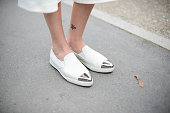 Micaela Quiroga Cucchietti poses wearing Miu Miu shoes on September 24 2014 in Paris France