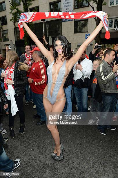 Micaela Schaefer pose in front of FC Bayern fans during the 8 Years Anniversary Bachmaier Hofbraeu at the Leopoldstrasse on May 11 2013 in Munich...