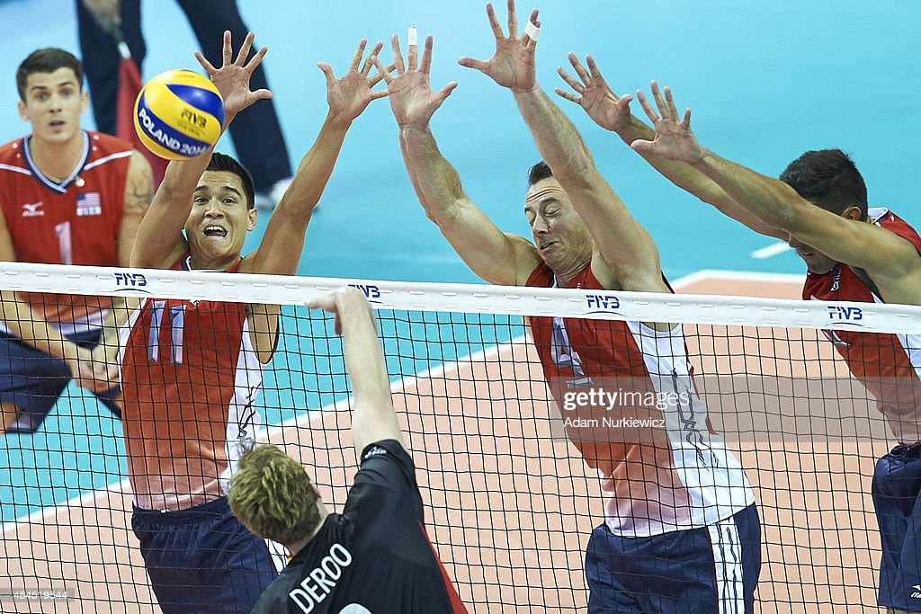 Micah Christenson and David Lee defends against Belgian Sam Deroo during the FIVB World Championships Volleyball at Cracow Arena on August 31, 2014 in Cracow, Poland.