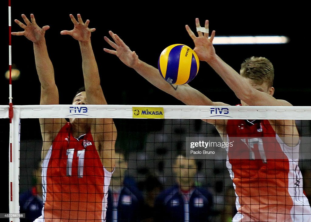 Micah Christenson and Holt Maxwell of United States block the ball during the FIVB World League Final Six match between United States and Australia at Mandela Forum on July 17, 2014 in Florence, Italy.