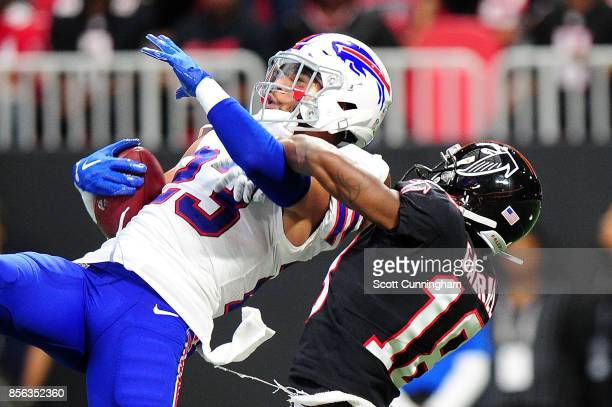 Micah Hyde of the Buffalo Bills intercepts a pass intended for Taylor Gabriel of the Atlanta Falcons during the second half at MercedesBenz Stadium...
