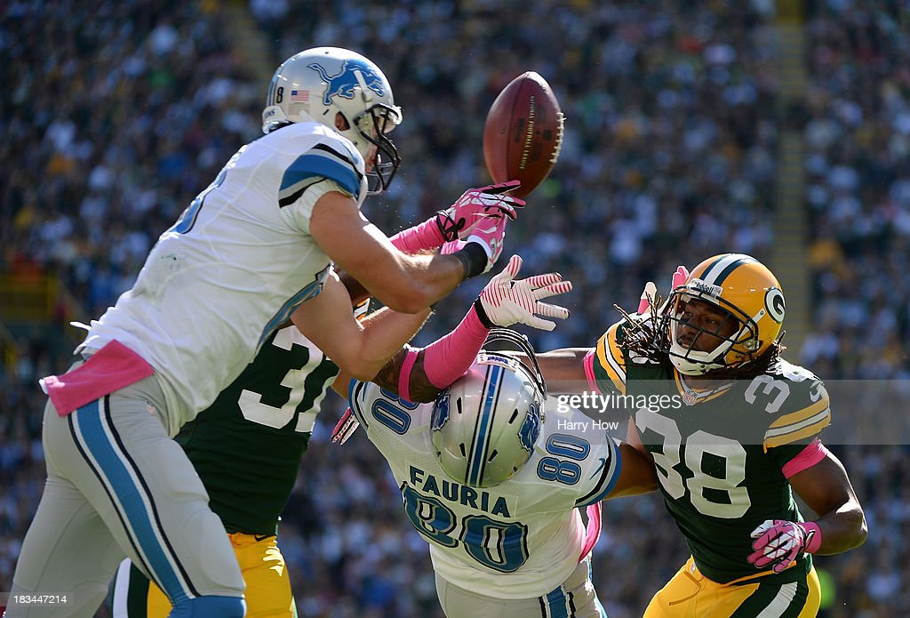 Micah Hyde #33 of the Green Bay Packers breaks up a pass in front of Joseph Fauria #80 and Kris Durham #18 of the Detroit Lions during the second quarter at Lambeau Field on October 6, 2013 in Green Bay, Wisconsin.