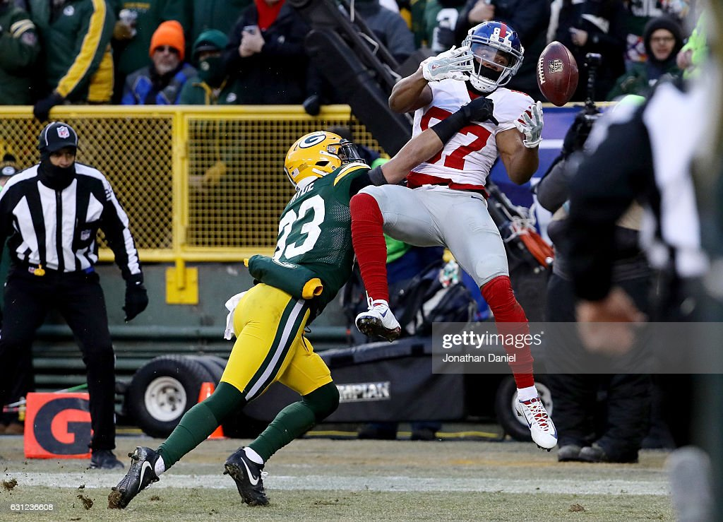 Micah Hyde #33 of the Green Bay Packers breaks up a pass intended for Sterling Shepard #87 of the New York Giants in the first quarter during the NFC Wild Card game at Lambeau Field on January 8, 2017 in Green Bay, Wisconsin.