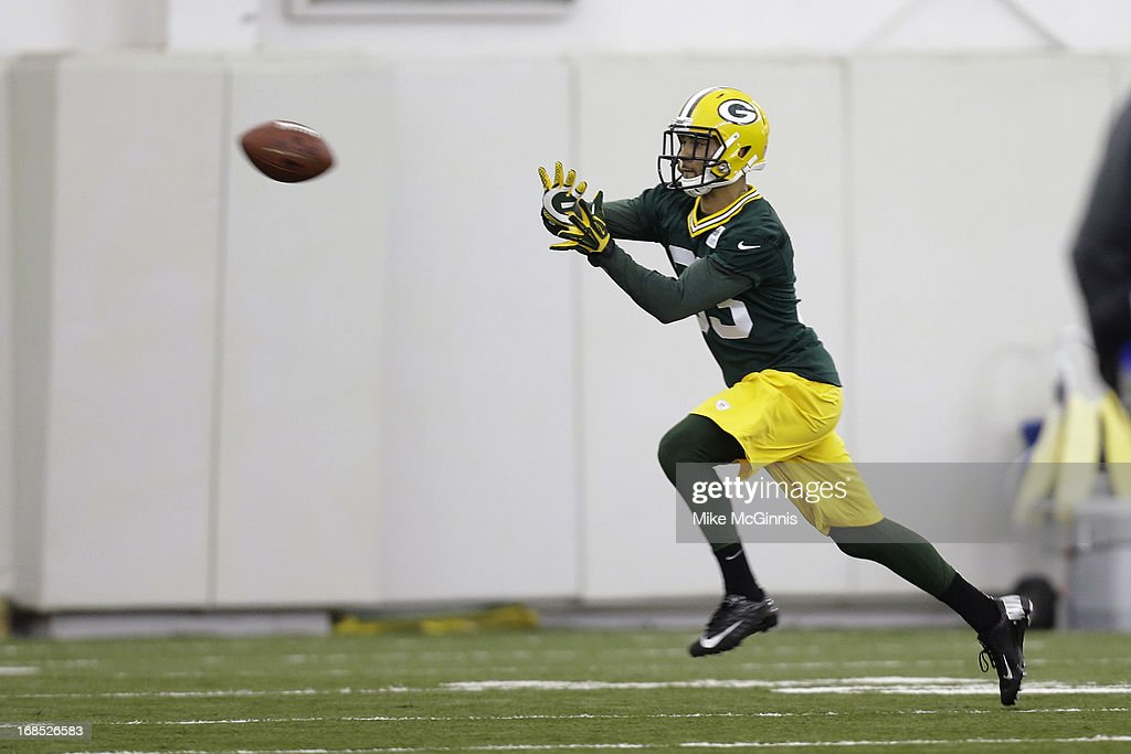 Micah Hyde #33 of the Green Bay Packers catches a pass a passing drill during rookie camp at the Don Hutson Center on May 10, 2013 in Green Bay, Wisconsin.