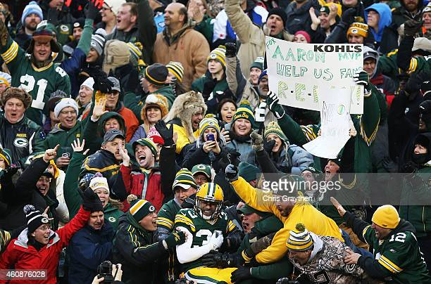 Micah Hyde of the Green Bay Packers celebrates his touchdown with fans in the first quarter against the Detroit Lions at Lambeau Field on December 28...