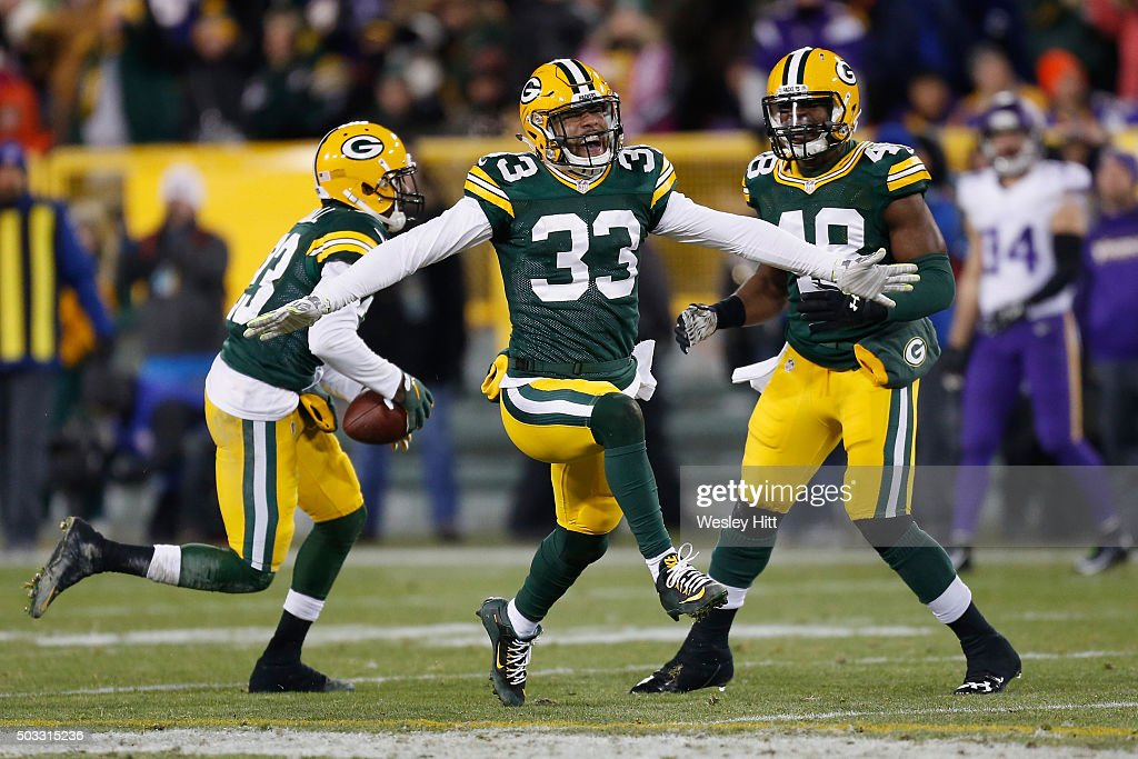 Micah Hyde #33 of the Green Bay Packers celebrates intercepting a pass during the third quarter against the Minnesota Vikings at Lambeau Field on January 3, 2016 in Green Bay, Wisconsin.