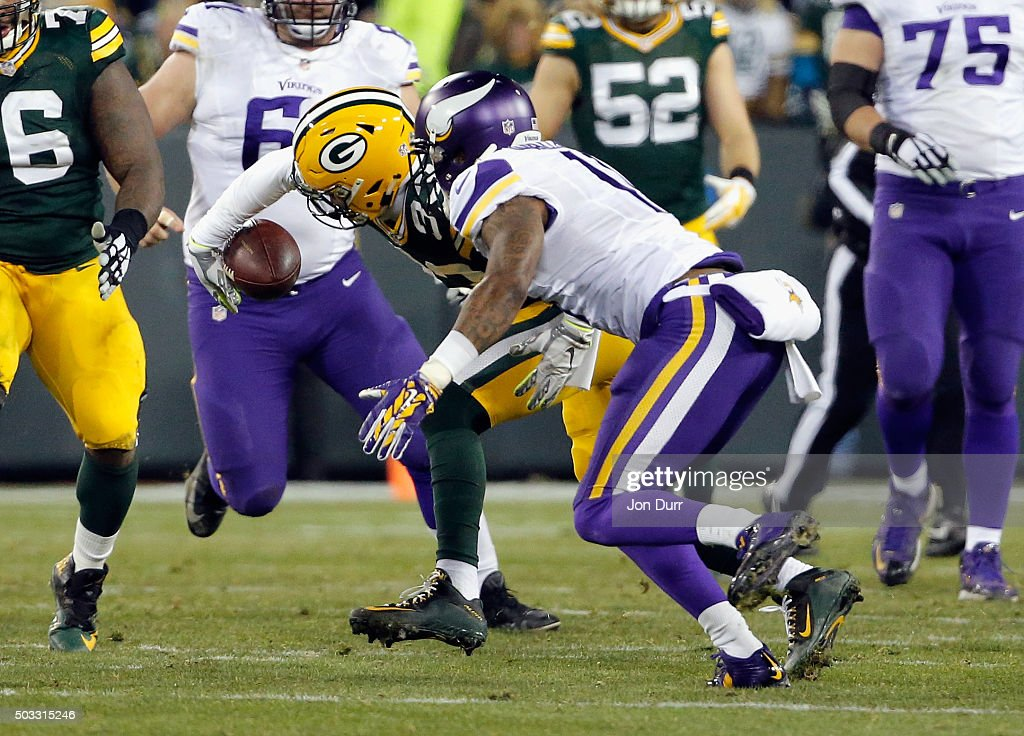 Micah Hyde #33 of the Green Bay Packers intercepts a pass intended for Mike Wallace #11 of the Minnesota Vikings during the third quarter of their game at Lambeau Field on January 3, 2016 in Green Bay, Wisconsin.