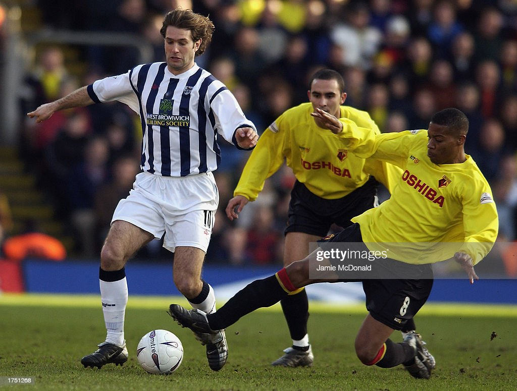 Micah Hyde of Watford tackles Andy Johnson of West Bromwich Albion