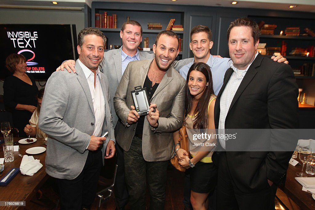 <a gi-track='captionPersonalityLinkClicked' href=/galleries/search?phrase=Micah+Jesse&family=editorial&specificpeople=4838538 ng-click='$event.stopPropagation()'>Micah Jesse</a> poses with Mophie executives at the Invisible Mobile Text App Preview at the Soho House on August 14, 2013 in New York City.