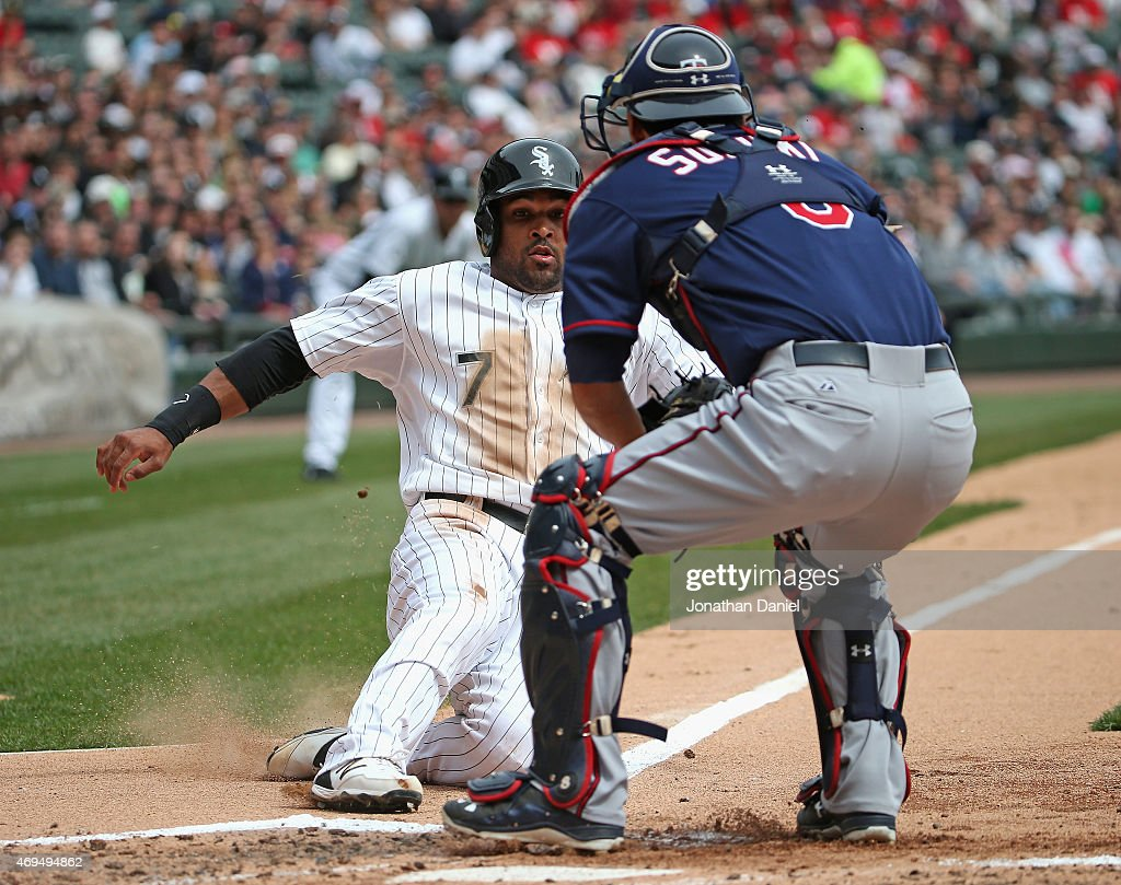 Micah Johnson #7 of the Chicago White Sox is forced out at the plate by Kurt Suzuki #8 of the Minnesota Twins in the 2nd inning at U.S. Cellular Field on April 12, 2015 in Chicago, Illinois.
