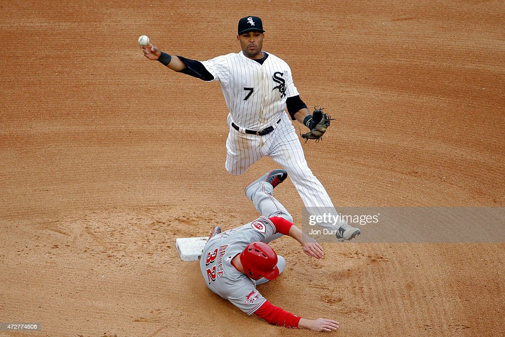 Micah Johnson #7 of the Chicago White Sox leaps in the air to throw to first base as Jay Bruce #32 of the Cincinnati Reds slides into second base during the sixth inning in the first game of a doubleheader on May 9, 2015 at U.S. Cellular Field in Chicago, Illinois.