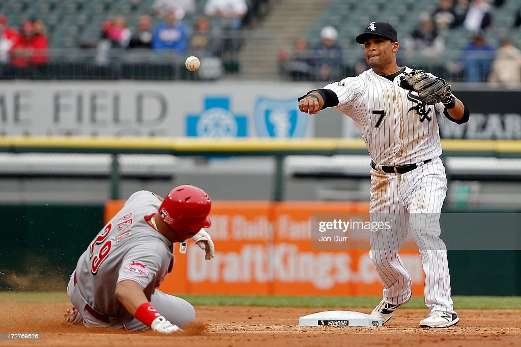 Micah Johnson #7 of the Chicago White Sox throws to first as Brayan Pena #29 of the Cincinnati Reds slides during the second inning in the first game of a doubleheader on May 9, 2015 at U.S. Cellular Field in Chicago, Illinois.