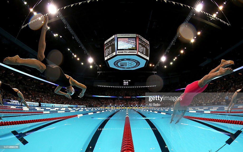 Micah Lawrence and Rebecca Soni dive off of the starting block as they compete in the Championship final of the Women's 200 m Breaststroke during Day Six of the 2012 U.S. Olympic Swimming Team Trials at CenturyLink Center on June 30, 2012 in Omaha, Nebraska.