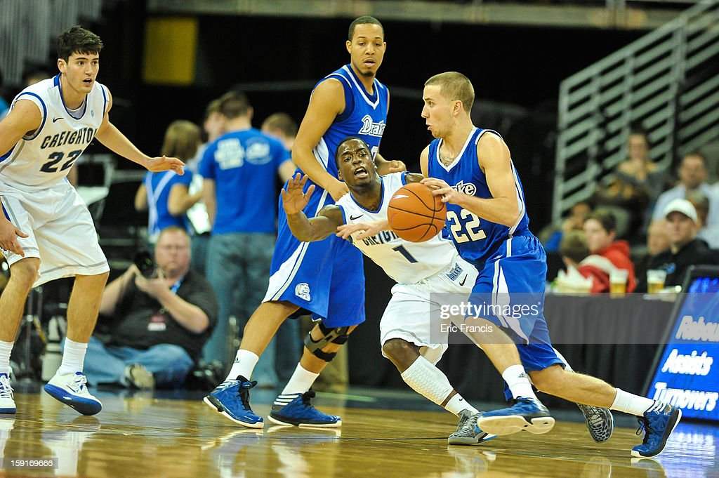 Micah Mason #22 of the Drake Bulldogs moves past Austin Chatman #1 of the Creighton Bluejays during their game at the CenturyLink Center on January 8, 2013 in Omaha, Nebraska. Creighton defeated Drake 91-61.