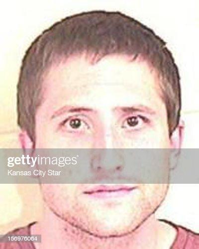 Micah Moore is seen in a police booking mug.