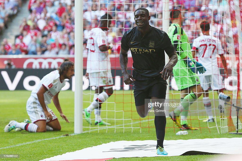 <a gi-track='captionPersonalityLinkClicked' href=/galleries/search?phrase=Micah+Richards&family=editorial&specificpeople=647038 ng-click='$event.stopPropagation()'>Micah Richards</a> of Manchester celebrates his team's second goal during the Audi Cup match between Manchester City and AC Milan at Allianz Arena on July 31, 2013 in Munich, Germany.