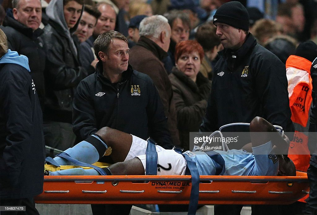 <a gi-track='captionPersonalityLinkClicked' href=/galleries/search?phrase=Micah+Richards&family=editorial&specificpeople=647038 ng-click='$event.stopPropagation()'>Micah Richards</a> of Manchester City is stretchered off with an injury during the Barclays Premier League match between Manchester City and Swansea City at the Etihad Stadium on October 27, 2012 in Manchester, England.