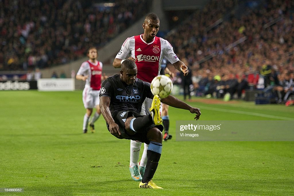 Micah Richards of Manchester City, Ryan Babel of Ajax during the Champions League match between Ajax Amsterdam and Manchester City at the Amsterdam Arena on October 24, 2012 in Amsterdam, The Netherlands.