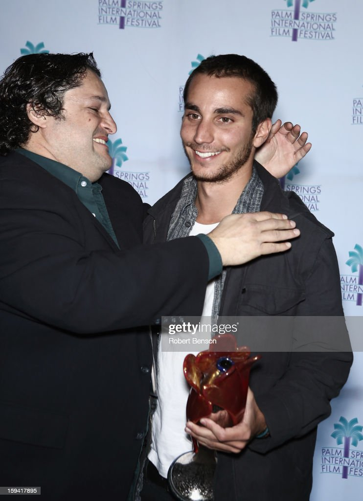 Micahel Kananack (L) congratulates Adrian Saba at a Festival Awards Brunch at the 24th Annual Palm Springs International Film Festival on January 13, 2013 in Palm Springs, California.
