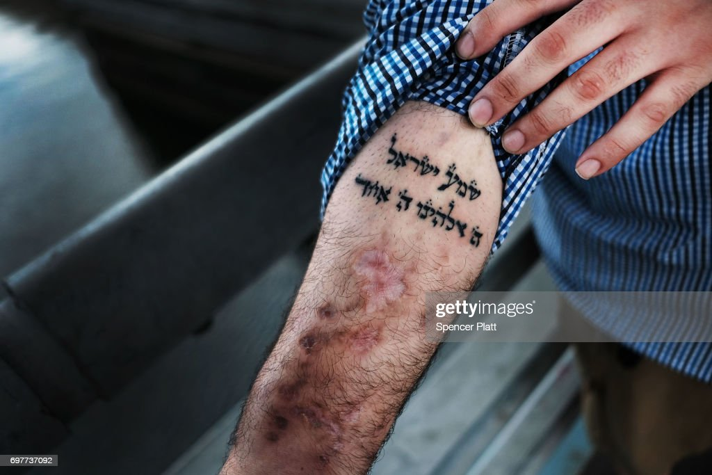 Michael, a patient at a Brooklyn methadone clinic for those addicted to heroin, displays a Hebrew tatoo of the 'shema' prayer in Judaism that he looks to in in his fight with addiction: 'Here, O Israel, the Lord is our God, the Lord is one' on June 19, 2017 in New York City. Newly released data shows that over 1,370 New Yorkers died from overdoses in 2016, the majority of those deaths involved opioids. According to the Deputy Attorney General, drug overdoses are now the leading cause of death for Americans under the age of 50.