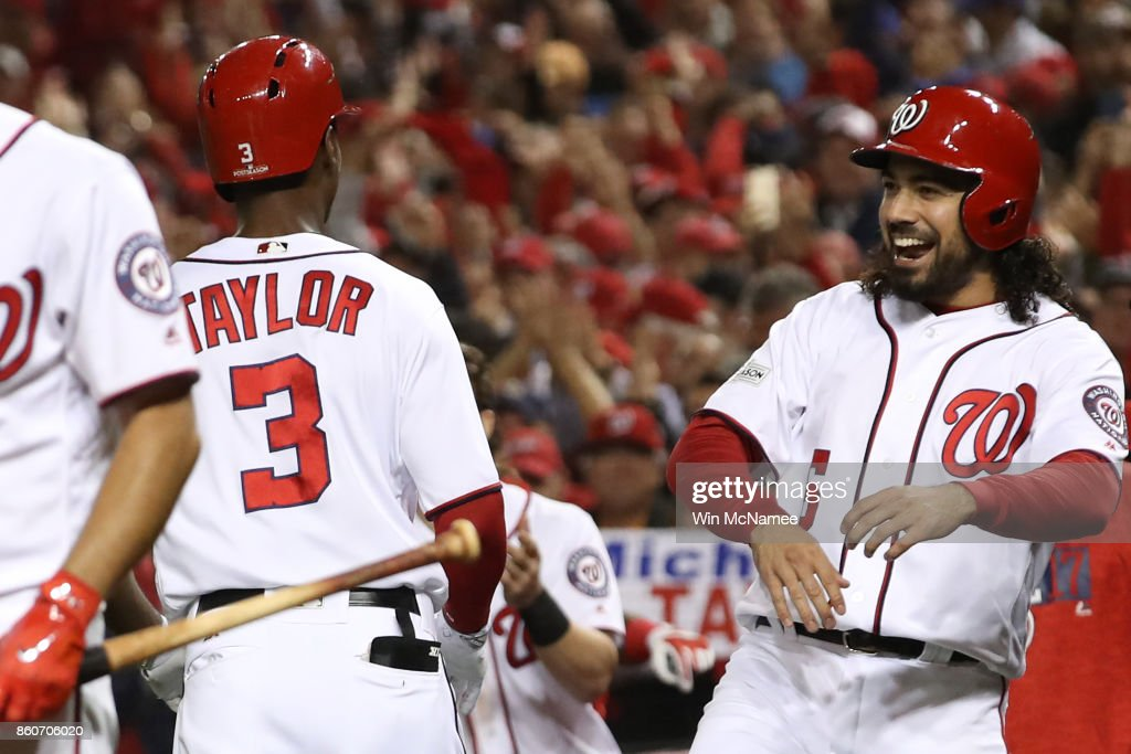 Michael A. Taylor #3 of the Washington Nationals celebrates with Anthony Rendon #6 of the Washington Nationals after hitting a three run home run against the Chicago Cubs during the second inning in game five of the National League Division Series at Nationals Park on October 12, 2017 in Washington, DC.