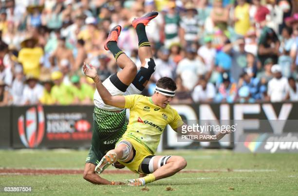 Michael Adams of Australia performs a dangerous tackle on Roscko Speckman of South Africa in their Cup semifinal match at the Sydney Sevens World...